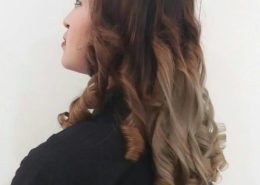 Side view of long curly hair with blonde ends - Kittn Salon & Spa - Beauty Parlour & hair salon Karnal +91 184 404 2229 174 – L, Model Town, Karnal, Haryana-132001